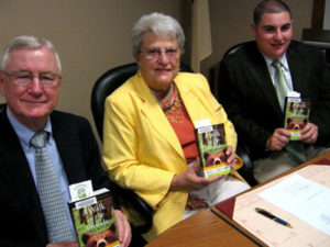Selectman Pacheco with Selectman McKinnon and  Selectwoman Smith as part of One Book, One Community.