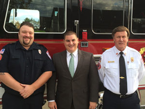 Raynham Fire Fighter Mike McRae, Selectman Pacheco, and  Raynham Fire Chief Jim Januse.