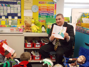 Selectman Pacheco participating with the Bridgewater-Raynham School District's Read Across America program.